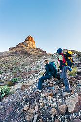 Female hikers below Cerro Castelon, Big Bend National Park, Texas, USA.