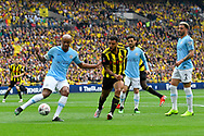 Vincent Kompany (4) of Manchester City clears the ball with Troy Deeney (9) of Watford bearing down on him during the The FA Cup Final match between Manchester City and Watford at Wembley Stadium, London, England on 18 May 2019.