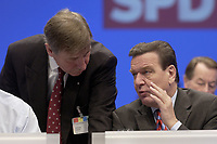 18 NOV 2003, BOCHUM/GERMANY:<br /> Wolfgang Clement (L), SPD, Bundeswirtschaftsminister, und  Gerhard Schroeder (R), SPD, Bundeskanzler, im Gespraech, SPD Bundesparteitag, Ruhr-Congress-Zentrum<br /> IMAGE: 20031118-01-031<br /> KEYWORDS: Parteitag, party congress, SPD-Bundesparteitag, Gerhard Schröder, Gespräch
