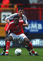 Jason Euell (Charlton) is held back by Aaron Hughes (Newcastle) Charlton v Newcastle, The Valley, 20/12/2003, Premiership Football. Credit : Colorsport / Robin Hume. Digital File Only.