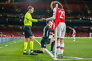 Arsenal midfielder Mattéo Guendouzi (29) demands a foul is given by Assistant Referee Guillame Debart after being pushed by Eintracht Frankfurt midfielder Filip Kostic (10) during the Europa League match between Arsenal and Eintracht Frankfurt at the Emirates Stadium, London, England on 28 November 2019.
