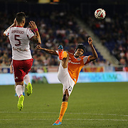 Ricardo Clark, (right), Houston Dynamo, clears while challenged by Armando, New York Red Bulls, during the New York Red Bulls Vs Houston Dynamo, Major League Soccer regular season match at Red Bull Arena, Harrison, New Jersey. USA. 4th October 2014. Photo Tim Clayton