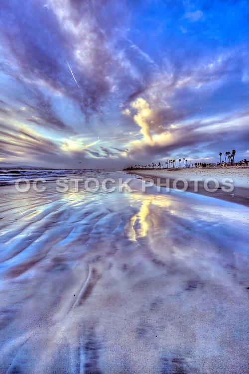 Storm Cloud Reflections on the Beach in Huntington Beach