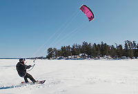 Craig Asher from Long Island, NY enjoys snow kiting on Lake Winnipesaukee from Ellacoya State Park in Gilford Tuesday afternoon.  (Karen Bobotas/for the Laconia Daily Sun)