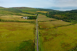 Aerial view from drone of single track rural road  on Kintyre peninsula part of the Kintyre 66 tourist driving route in Argyll & Bute, Scotland UK