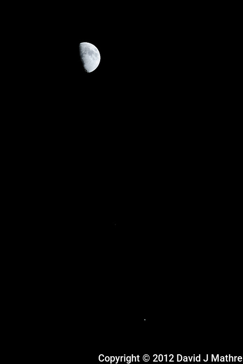 Moon with Jupiter in Conjunction. Image taken with a Nikon D3x and 300 mm f/2.8 VR lens (ISO 100, 300 mm, f/5.6, 1/100 sec).