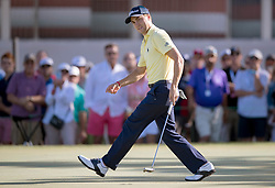 February 25, 2018 - Palm Beach Gardens, Florida, U.S. - Justin Thomas reacts to missing a birdie putt on the 10th hole with the Honda Classic trophy at PGA National Resort and Spa in Palm Beach Gardens, Florida on February 25, 2018. (Credit Image: © Allen Eyestone/The Palm Beach Post via ZUMA Wire)