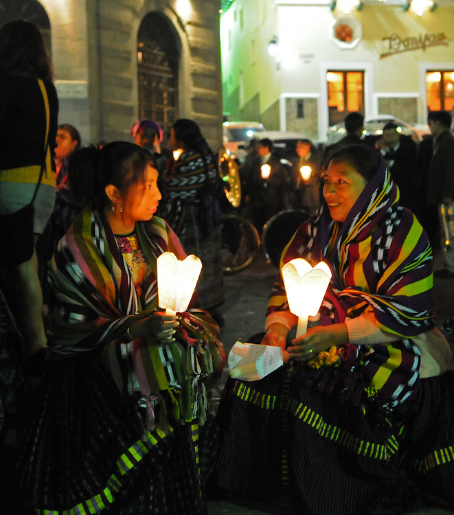 Apr 19, 2011 - Quetzaltenago, Guatemala - Two women dressed in traditional clothes sit in central park as the procession they are apart of the Procession of Jesus De La Pacencia pauses Tuesday night. The procession is one of many that will take place during Semana Santa or Holy Week in Guatemala, which runs from Palm Sunday to Holy Saturday..(Credit Image: © Josh Bachman/ZUMA Press)