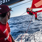 Leg 8 from Itajai to Newport, day 06 on board MAPFRE, Antonio Cuervas-Mons at the sail, Blair looking at him. 27 April, 2018.