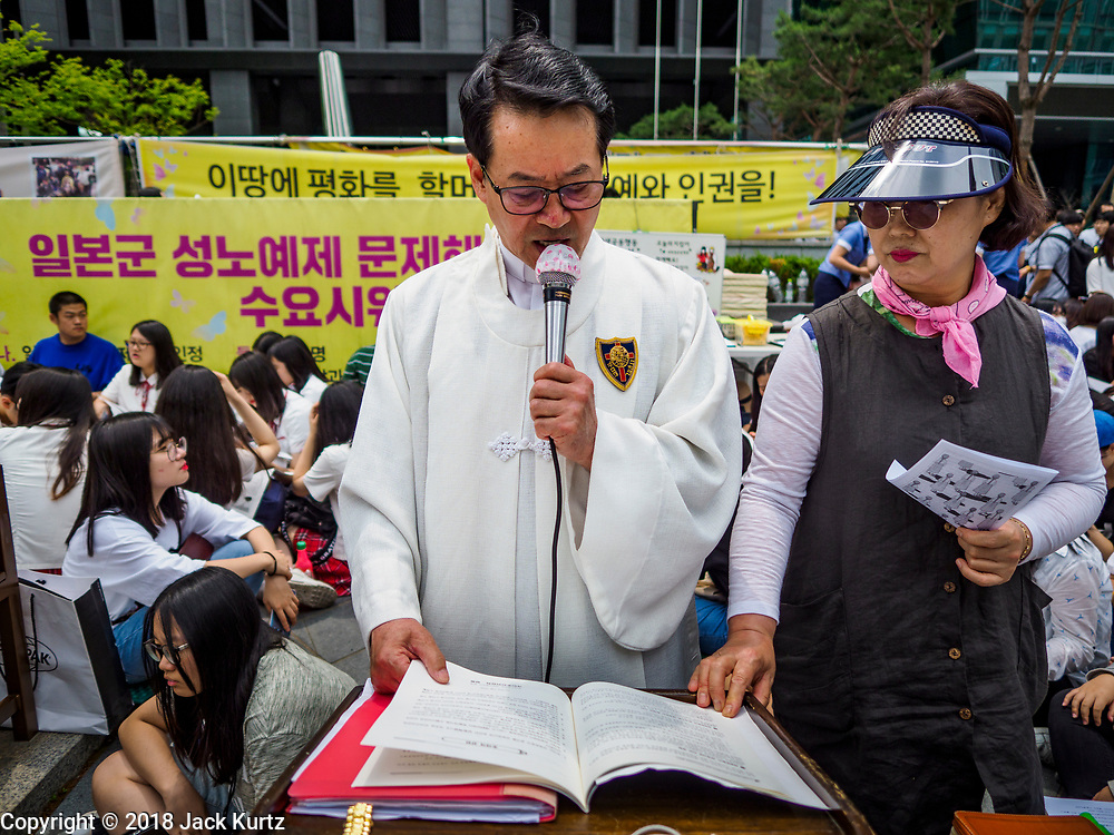 """SEOUL, SOUTH KOREA: A Catholic priest leads prayers during the Wednesday protest in front of the Japanese embassy in Seoul. The Wednesday protests have been taking place since January 1992. Protesters want the Japanese government to apologize for the forced sexual enslavement of up to 400,000 Asian women during World War II. The women, euphemistically called """"Comfort Women"""" were drawn from territories Japan conquered during the war and many came from Korea, which was a Japanese colony in the years before and during the war. The """"comfort women"""" issue is still a source of anger of many people in northeast Asian areas like South Korea, Manchuria and some parts of China.       PHOTO BY JACK KURTZ   <br /> Wednesday Demonstration demanding Japan to redress the Comfort Women problems"""