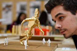 """© Licensed to London News Pictures. 11/05/2017. London, UK. A visitor views a work by Emin Zargarian at an exhibition called """"Up and Coming"""", in Granary Square King's Cross.  The exhibition includes works by Central Saint Martins foundation students.   Photo credit : Stephen Chung/LNP"""