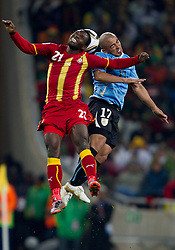 Kwadwo Asamoah of Ghana vs Egidio Arevalo of Uruguay during the overtime at 2010 FIFA World Cup South Africa Quarter Finals football match between Uruguay and Ghana on July 02, 2010 at Soccer City Stadium in Sowetto, suburb of Johannesburg. Uruguay defeated Ghana after penalty shots. (Photo by Vid Ponikvar / Sportida)