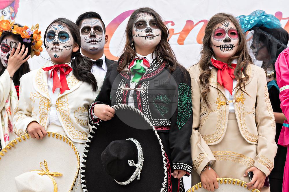 High School students compete in a Catrina Day of the Dead costume contest during Día de los Muertos festival October 31, 2017 in Patzcuaro, Michoacan, Mexico.
