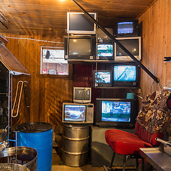 Closed circuit televisions transmit live video from sap pump houses to the sugarhouse at the LaRiviere maple syrup operation in Big Six Township, Maine.
