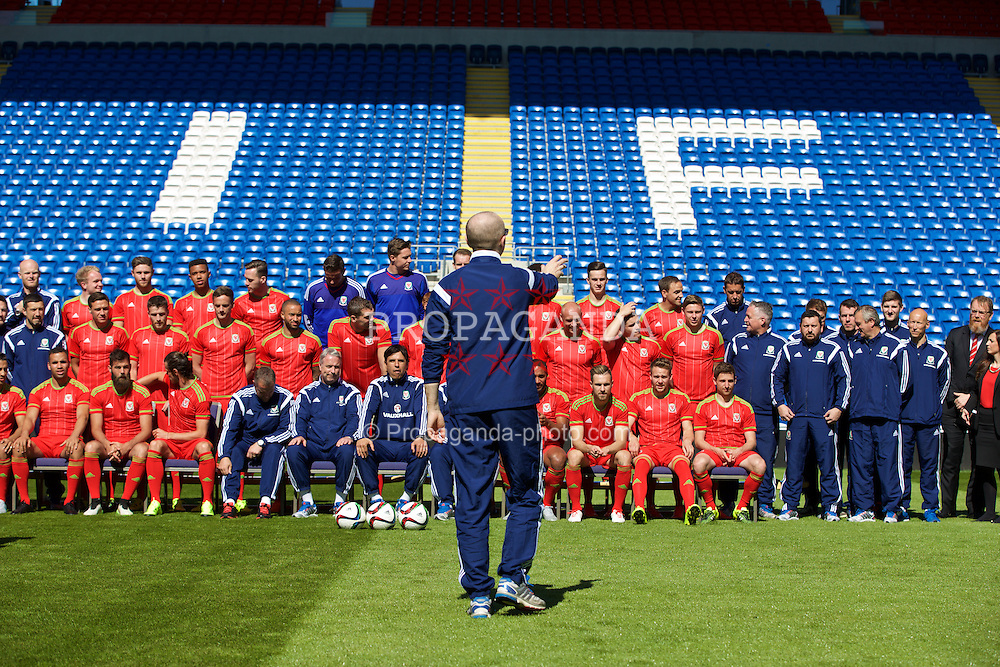 CARDIFF, WALES - Wednesday, June 3, 2015: Photographer David Rawcliffe organises the Wales team photo at the Cardiff City Stadium ahead of the UEFA Euro 2016 Qualifying Round Group B match against Belgium. (Pic by Mark Hawkins/Propaganda)