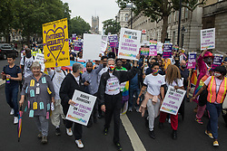 Peter Tatchell, veteran LGBTI+ and human rights campaigner, leads thousands of LGBTI+ protesters along Whitehall on the first-ever Reclaim Pride march on 24th July 2021 in London, United Kingdom. Reclaim Pride replaced the traditional Pride in London march, which many feel has become too commercial and strayed from its roots in protest, and was billed as a People's Pride march for LGBTI+ liberation. Campaigners called for the banning of LGBTI+ conversion therapy, the reform of the Gender Recognition Act, the provision of a safe haven for LGBTI+ refugees and for LGBTI+ people to be decriminalised worldwide and marched in solidarity with Black Lives Matter.