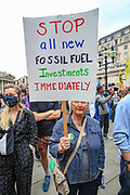 """Demonstrators hold placards during an Extinction Rebellion fifth day of two-week protest campaign outside the Bank of England in London on Friday, Aug 27, 2021.<br /> Activists said that the wealth of this country is """"blood wealth"""" as to this day the country use its financial and armed power to exploit resources elsewhere. (VX Photo/ Vudi Xhymshiti)"""