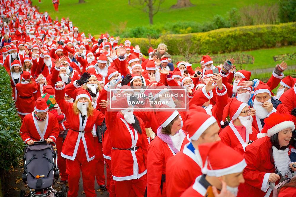 Over 1600 Santa's take part in Scotland's fundraising Santa's run, walk and stroll around Edinburgh's West Prices Street Gardens, raising money to grant the Wishes of Children for When You Wish Upon A Star. Sunday 11th December 2016. (c) Brian Anderson   Edinburgh Elite media