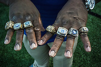 Former teacher and team videographer Rodney Ford wears all seven of the section and state championship rings as they host the Burbank High School Titans in their football match, Friday August 28, 2015.<br /> Brian Baer/Special to the Bee