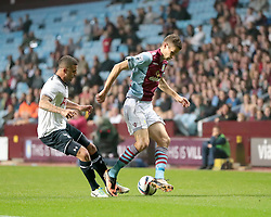 Aston Villa's Nicklas Helenius is challenged by Tottenham Hotspur's Kyle Walker  - Photo mandatory by-line: Nigel Pitts-Drake/JMP - Tel: Mobile: 07966 386802 24/09/2013 - SPORT - FOOTBALL -  Villa Park - Birmingham - Aston Villa v Tottenham Hotspur - Round 3 - Capital One Cup