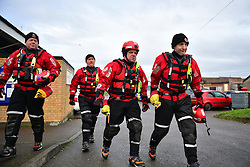 © Licensed to London News Pictures. 13/01/2017. Jaywick, UK. Members of search and rescue teams on the seafront at Jaywick before Homes are evacuated due to the threat of flooding in low-lying areas . Photo credit: Ben Cawthra/LNP