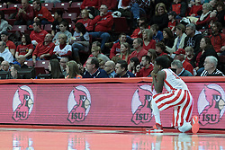 01 February 2014:  Daishon Knight waits next to the official bench to get in to the game during an NCAA Missouri Valley Conference (MVC) mens basketball game between the Drake Bulldogs and the Illinois State Redbirds  in Redbird Arena, Normal IL.