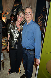 ROBERT FOX and his wife FIONA GOLFAR at a party to celebrate the publication of 'A Girl From Oz' by Lyndall Hobbs held at Flat 1, 165 Cromwell Road, London on 12th May 2016.