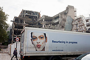 A Boots retail lorry and demolition of an old office block, on 21st September 2016, in Waterloo, SE1, south London borough of Southwark, England UK. A programme of redevelopment is underway on the corner of Stamford Street and Blackfriars Bridge Road in SE1.