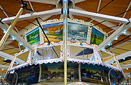 Garden City, New York, USA. March 9, 2019.  Painted panels on Nunley's Carousel have scenes of famous Long Island locations, including parks, and events.