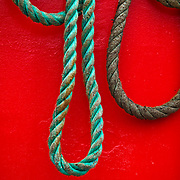 rope loops against red background, Yaquina Harbor