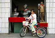 SHAOSHAN, CHINA - 4 NOVEMBER 2005 - A young girl in plays in front of her parents' Mao souvenir shop in Shaoshan. Three decades after his death, despite wide recognition that he committed grave errors that caused the deaths of tens of millions, Mao is still regarded by many as the country's greatest leader. Photo by Natalie Behring