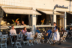 Late afternoon view of bohemian Fleischerei restaurant in Prenzlauer Berg Berlin Germany
