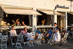 Late afternoon view of bohemian Fleischerei restaurant in Prenzlauer Berg Berlin Germany