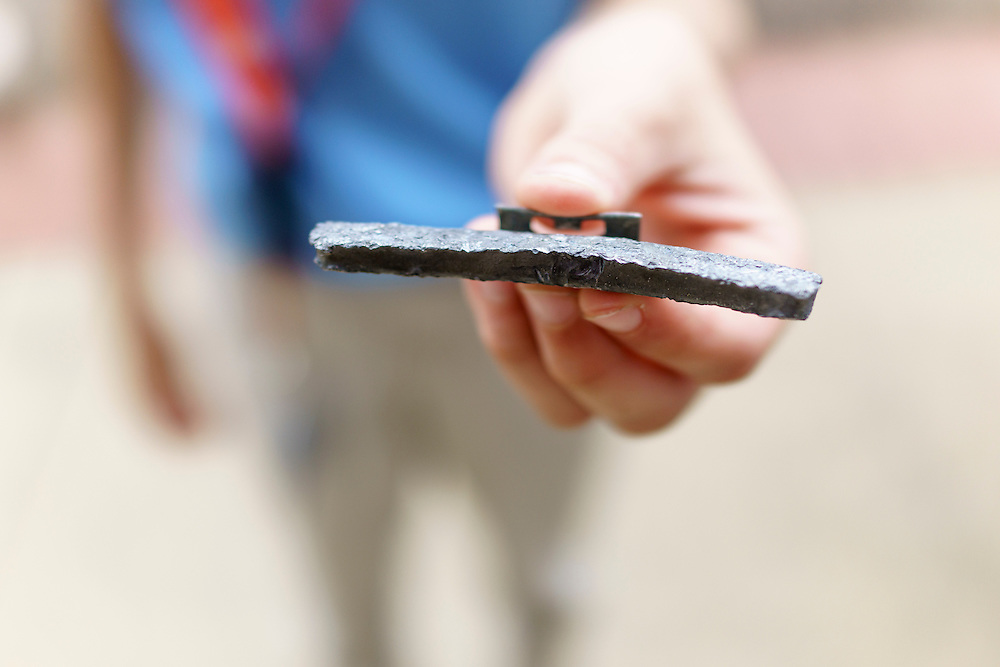Washington, D.C. - October 07, 2016: Elliot Turner holds up an in tact lead wheel weight he and other members of The Hyperbolics found a block from the EPA building along Constitution Ave., in Washington D.C.<br /> <br /> The Hyperbolics are a First Lego League team based out of Sterling School in Greenville SC, who made a trip to DC ask government officials to ban lead wheel weights Friday October 7, 2016.<br /> <br /> <br /> CREDIT: Matt Roth for Earthjustice