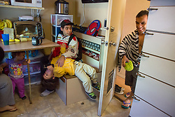 """Brazilian actor Paulo Cesar Oliveira dos Santos gets ready for a performance in the train car he lives in with his family.<br /> <br /> Ringling Bros. and Barnum & Bailey Circus started in 1919 when the circus created by James Anthony Bailey and P. T. Barnum merged with the Ringling Brothers Circus. Currently, the circus maintains two circus train-based shows, the Blue Tour and the Red Tour, as well as the truck-based Gold Tour. Each train is a mile long with roughly 60 cars: 40 passenger cars and 20 freight. Each train presents a different """"edition"""" of the show, using a numbering scheme that dates back to circus origins in 1871 — the first year of P.T. Barnum's show."""