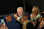 Democratic presidential candidate former Vice President Joe Biden shakes hands with SC State Senator Marlon Kimpson during his victory party after winning the South Carolina primary February 29 2020, in Columbia, South Carolina.