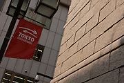 A street banner with the arrows emblem of the Tokyo Stock Exchange on it next to part of the wall of the stock exchange in Nihonbashi., Tokyo, Japan. Wednesday October 14th 2009. Established on May 15th 1878 the Tokyo Stock Exchange was one of the first stock exchanges in the world to fully computerize trading and now deals with over 700 trillion Yens worth of stock transaction annually, representing over 90 percent of all share dealings in the country.
