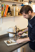 Fergus Drennan , known as 'Fergus the Forager' preparing a road-kill squirrel to eat at home in Chartham, Kent, UK