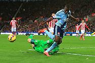 Stoke's Asmir Begovic saves an advance from West Ham's Ennier Valencia - Stoke City vs. West Ham United - Barclay's Premier League - Britannia Stadium - Stoke - 01/11/2014 Pic Philip Oldham/Sportimage