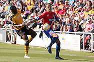 Dagenham's Matt Partridge (r) challenges for the ball with Newport's David Tutonda. Skybet football league two match , Newport county v Dagenham & Redbridge at Rodney Parade in Newport, South Wales on Saturday 18th April 2015.<br /> pic by David Richards, Andrew Orchard sports photography.