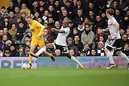 Fulham striker Sone Aluko (24) tackling Preston North End attacker Aiden McGeady (14) during the EFL Sky Bet Championship match between Fulham and Preston North End at Craven Cottage, London, England on 4 March 2017. Photo by Matthew Redman.