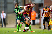 AFC Wimbledon defender Jonathan Meades (3) tackles Bradford City defender Anthony McMahon (29)  during the EFL Sky Bet League 1 match between Bradford City and AFC Wimbledon at the Coral Windows Stadium, Bradford, England on 22 April 2017. Photo by Simon Davies.