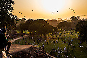 """29th January 2015, New Delhi, India. View of the grounds of Feroz Shah Kotla as believers move through them praying, making offerings and asking for their wishes to be granted by Djinns in the ruins of Feroz Shah Kotla in New Delhi, India on the 29th January 2015<br /> <br /> PHOTOGRAPH BY AND COPYRIGHT OF SIMON DE TREY-WHITE a photographer in delhi. + 91 98103 99809. Email:simon@simondetreywhite.com<br /> <br /> People have been coming to Firoz Shah Kotla to leave written notes and offerings for Djinns in the hopes of getting wishes granted since the late 1970's. Jinn, jann or djinn are supernatural creatures in Islamic mythology as well as pre-Islamic Arabian mythology. They are mentioned frequently in the Quran  and other Islamic texts and inhabit an unseen world called Djinnestan. In Islamic theology jinn are said to be creatures with free will, made from smokeless fire by Allah as humans were made of clay, among other things. According to the Quran, jinn have free will, and Iblīs abused this freedom in front of Allah by refusing to bow to Adam when Allah ordered angels and jinn to do so. For disobeying Allah, Iblīs was expelled from Paradise and called """"Shayṭān"""" (Satan).They are usually invisible to humans, but humans do appear clearly to jinn, as they can possess them. Like humans, jinn will also be judged on the Day of Judgment and will be sent to Paradise or Hell according to their deeds. Feroz Shah Tughlaq (r. 1351–88), the Sultan of Delhi, established the fortified city of Ferozabad in 1354, as the new capital of the Delhi Sultanate, and included in it the site of the present Feroz Shah Kotla. Kotla literally means fortress or citadel."""