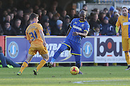 Tom Elliott of AFC Wimbledon and James Blaxendale of Mansfield Town battle  during the Sky Bet League 2 match between AFC Wimbledon and Mansfield Town at the Cherry Red Records Stadium, Kingston, England on 16 January 2016. Photo by Stuart Butcher.