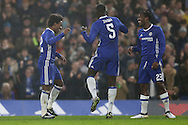 Willian of Chelsea (l) celebrates after scoring his sides 3rd goal with Kurt Zouma of Chelsea (c) and Michy Batshuayi of Chelsea. The Emirates FA cup, 3rd round match, Chelsea v Peterborough Utd at Stamford Bridge in London on Sunday 8th January 2017.<br /> pic by John Patrick Fletcher, Andrew Orchard sports photography.
