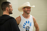 """DALLAS, TX - MARCH 13:  Donald """"Cowboy"""" Cerrone speaks with Phil """"C.M. Punk"""" Brooks backstage before the UFC 185 weigh-ins at the Kay Bailey Hutchison Convention Center on March 13, 2015 in Dallas, Texas. (Photo by Cooper Neill/Zuffa LLC/Zuffa LLC via Getty Images) *** Local Caption *** Donald Cerrone; Phil Brooks; C.M. Punk"""