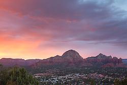 United States, Arizona, Sedona, sunset behind city