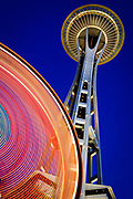 Seattle's Space Needle and colorful ferris wheel