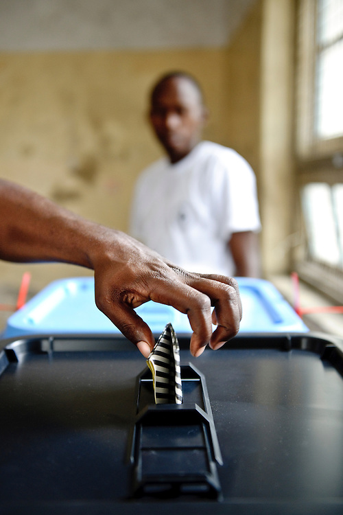 USE ARROWS ← → on your keyboard to navigate this slide-show<br /> <br /> Dar Es Salaam, Tanzania, 31 October 2010<br /> A Tanzanian man casts his vote in a polling station of Dar Es Salaam during the presidential election day.<br /> The European Union has launched an Election Observation Mission in Tanzania to monitor the general elections, responding to the Tanzanian government invitation to send observers for all aspects of the electoral process.<br /> The EU sent this observation mission led by Chief Observer David Martin, a member of the European Parliament. <br /> Photo: Ezequiel Scagnetti