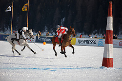 Bautista Ortiz de Urbina for team Switzerland going for the ball with Pablo Jauretche of the Germany<br /> Match Germany - Switzerland<br /> St.Moritz Polo World Cup On Snow 2011<br /> © Dirk Caremans